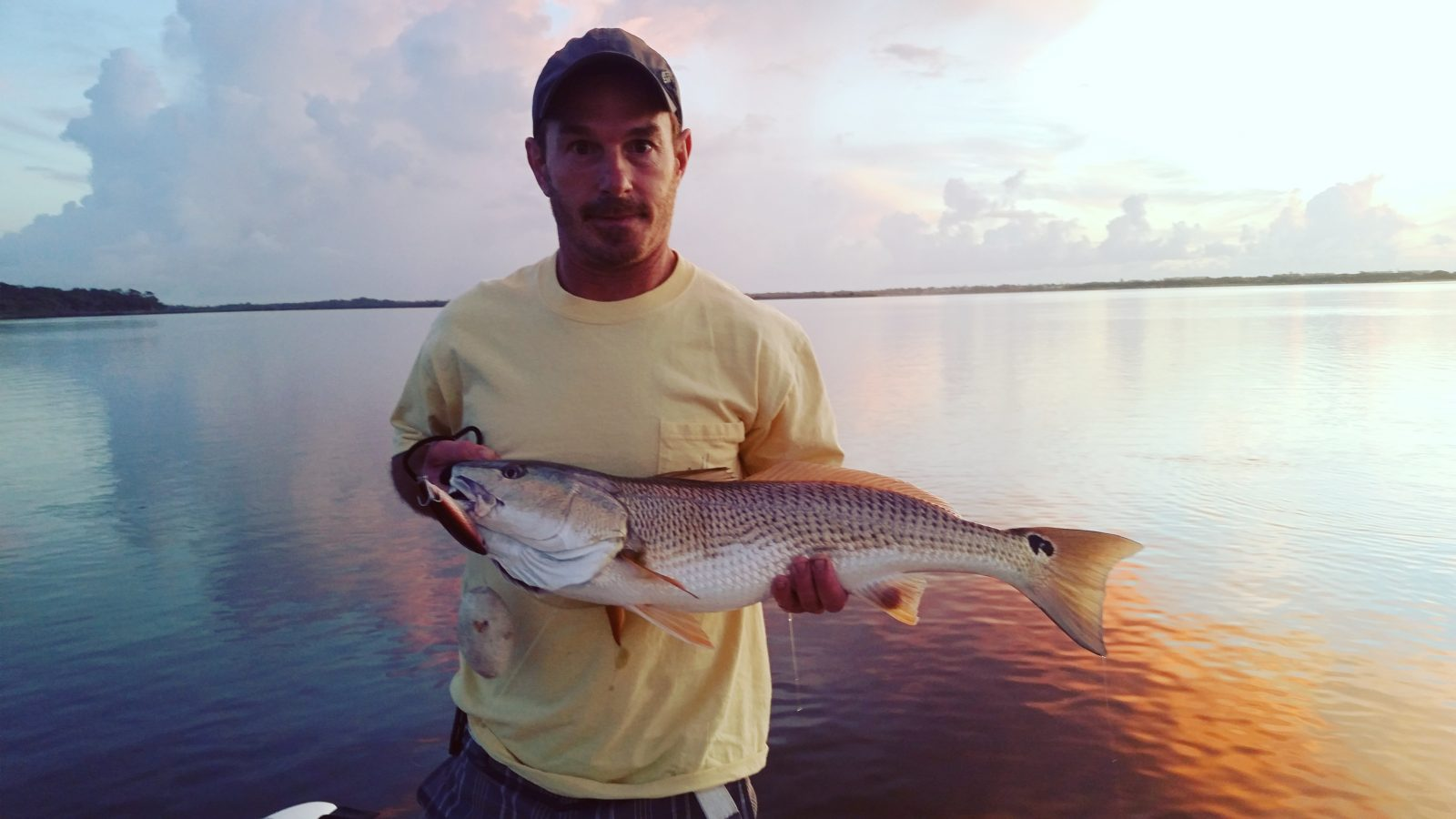 Jason Denton with a nice oversized red out of Ormond Beach FL